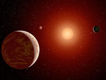 Artist rendering of a red dwarf or M star, with three exoplanets orbiting. About 75 percent of all stars in the sky are the cooler, smaller red dwarfs. IMAGE CREDIT: NASA.